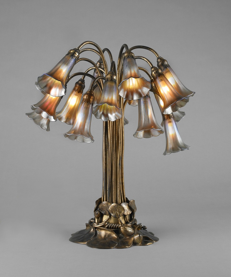 Tiffany Studios (American, est. 1902). 18-light lily table lamp, c. 1910. Favrile glass and gilt bronze. Photograph by John Faier for the Richard H. Driehaus Museum.
