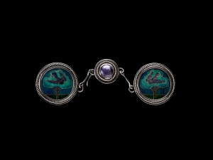 "Attributed to Nelson Dawson (English, 1859-1941)  Attributed to Edith Dawson (English, 1862-1928) ""Birds in the Trees"" Cloak Clasp, c. 1900 Silver, enamel Collection of Richard H. Driehaus"