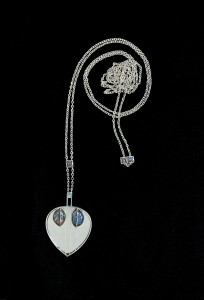 Josef Hoffmann (Austrian, 1870-1956)                                                     Wiener Werkstätte (Austrian, 1903-1932) Pendant, 1904 Silver, opal, mirrored glass Private Collection