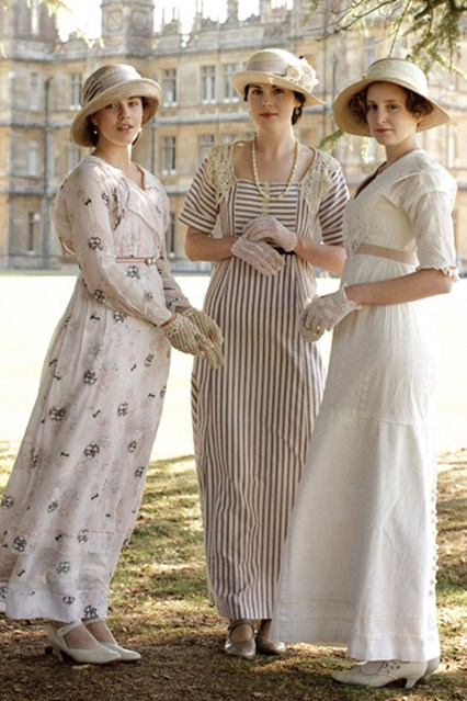 The three Crawley sisters of Downton Abbey wear breezy afternoon gowns, hats, and gloves. ©Carnival Films / Masterpiece