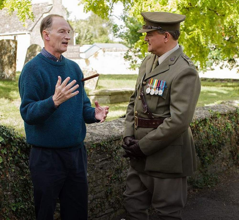 Alastair Bruce with actor Hugh Bonneville on the set of Downton Abbey.