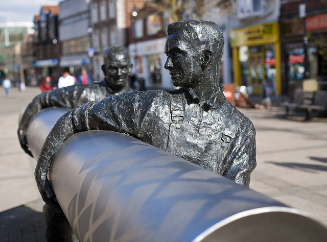 Statue of linoleum workers on the high street of Staines-Upon-Thames, England, commemorating the workers of Walton's factory.