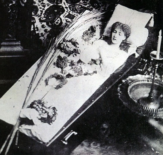 Sarah Bernhardt posing in a coffin, late 19th century.