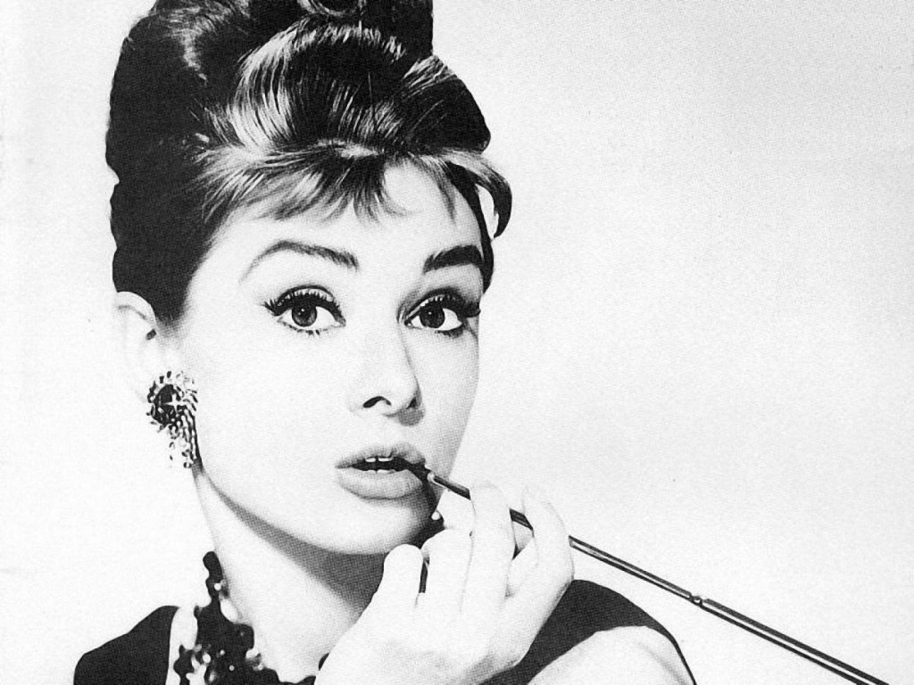 Audrey Hepburn (1929 - 1993) smoking using a long, slender cigarette holder. The actress and icon smoked heavily from the age of 15, and her drinking and smoking habits were seen as part of her sexual allure.
